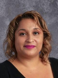 Ms. Yvette Helmi
